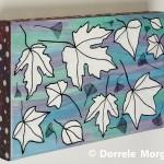 Snow Clad Winter Leaves On Box